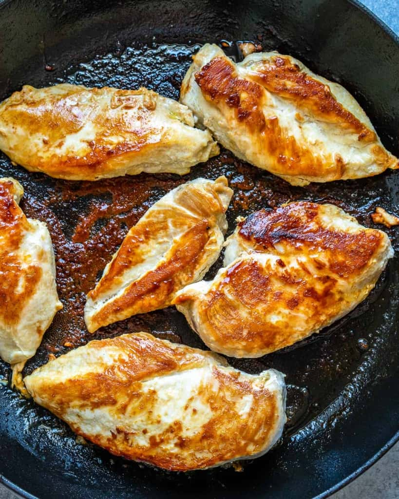 cooked chicken breast in skillet