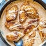 top view creamy cajun chicken in skillet