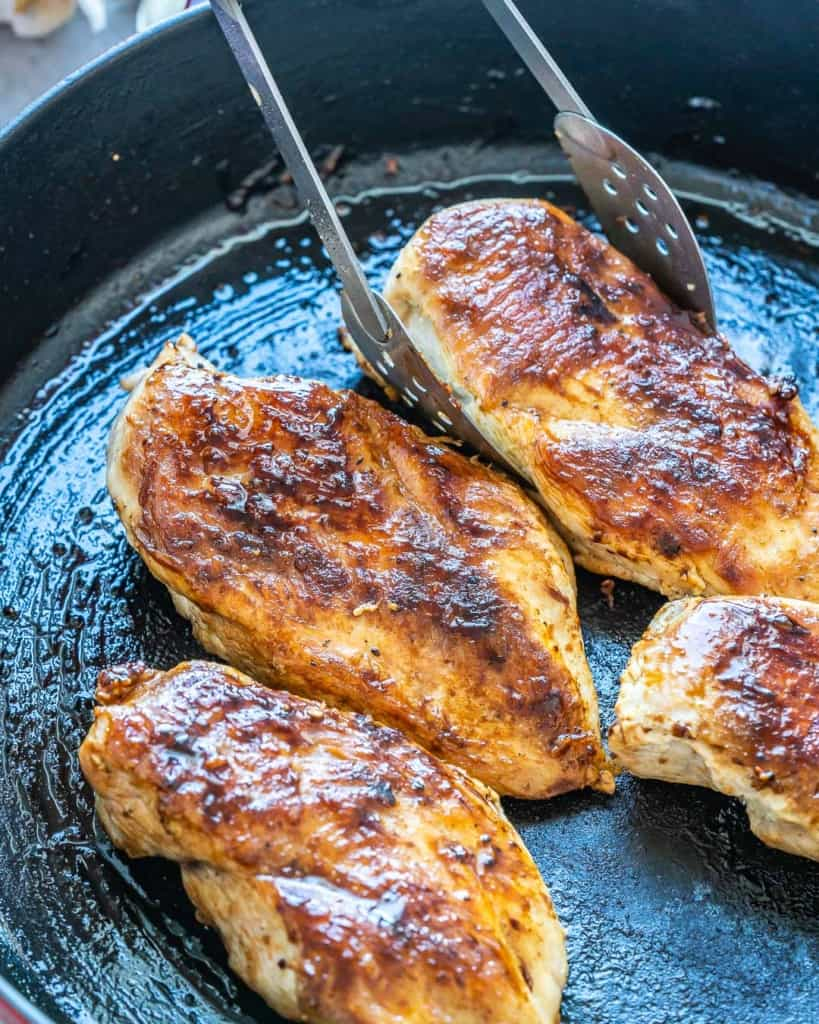 cooked chicken breast on a skillet