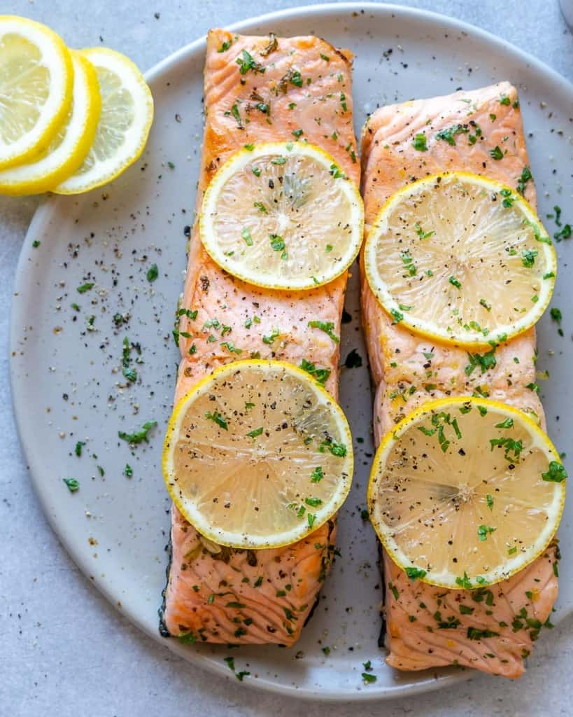 top view of two baked salmon filets on a plate