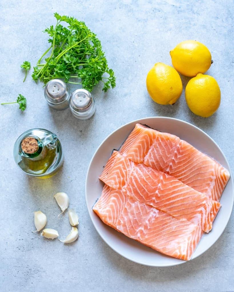 ingredients to make the lemon garlic salmon-salmon filets, lemons, garlic, salt and pepper, fresh parsley