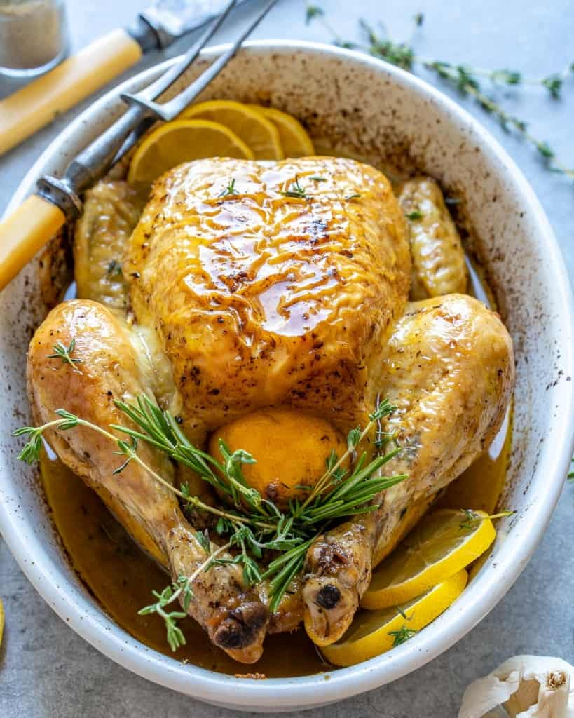 whole roasted chicken in a bowl