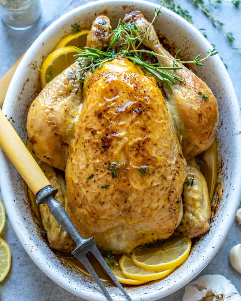 top view or roasted chicken in white dish