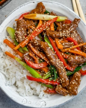 mongolian beed with rice in a white bowl
