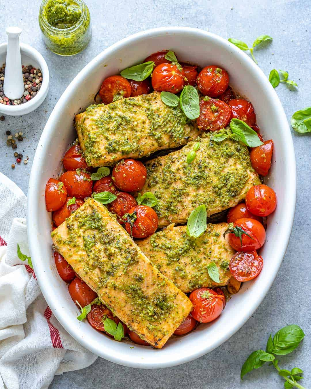 Full baking dish of salmon fillets and cherry tomatoes after baking