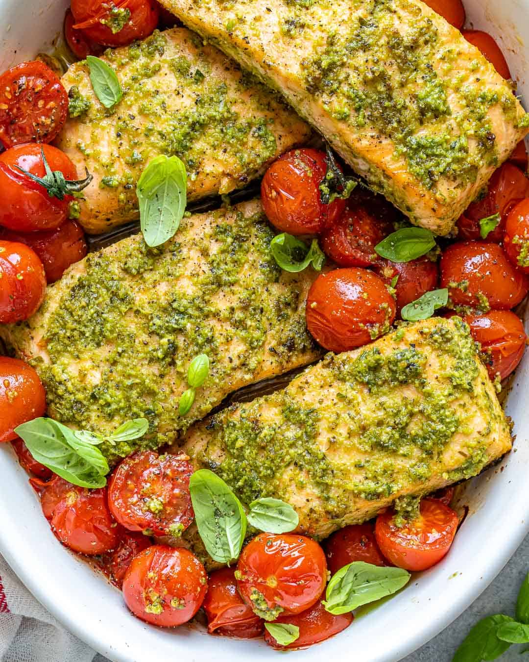 baked salmon and tomatoes in white dish