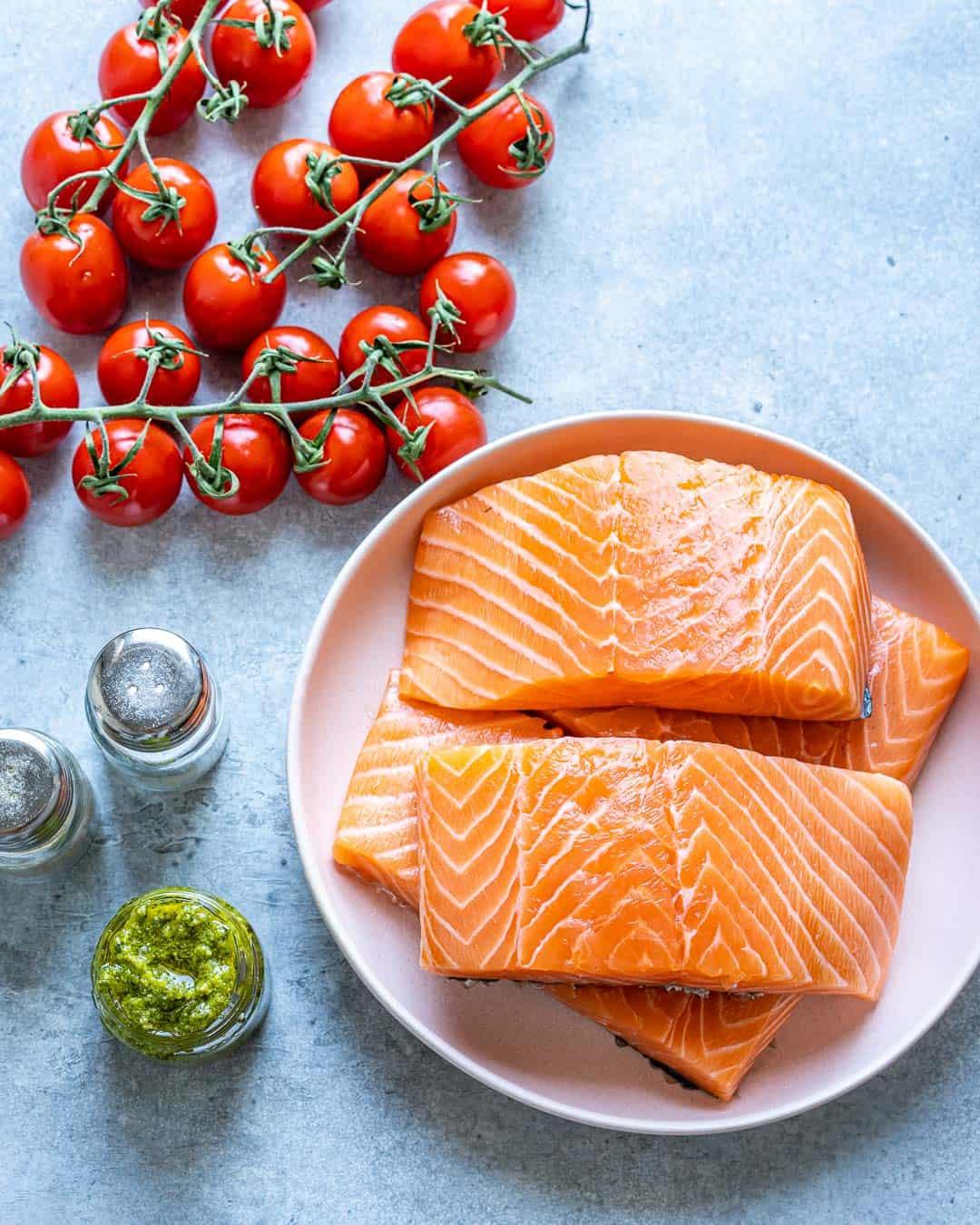 Ingredients for pesto salmon on counter