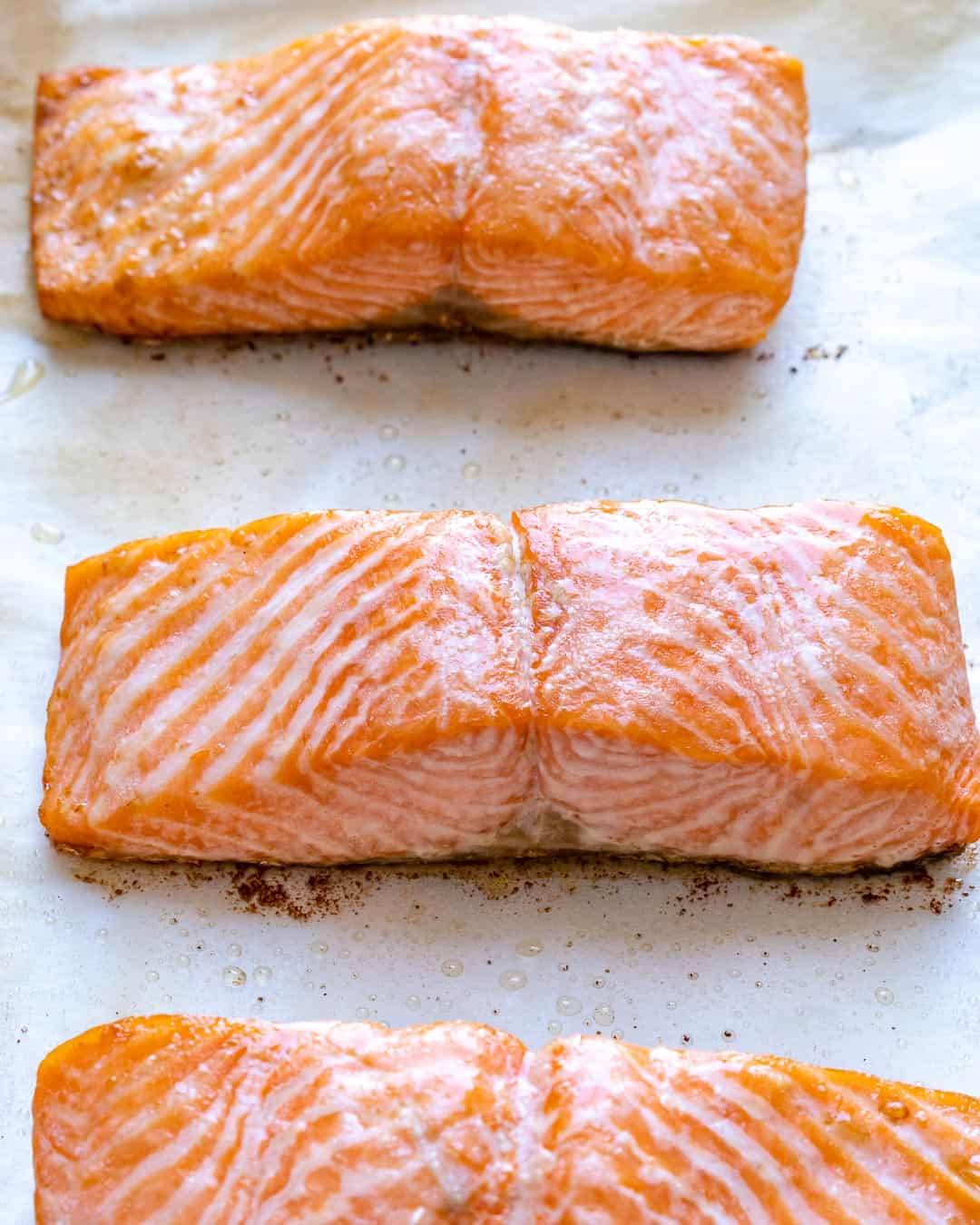 Salmon filets cooking in hot skillet