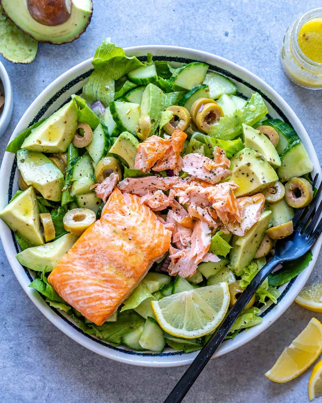 salmon topped over salad bowl