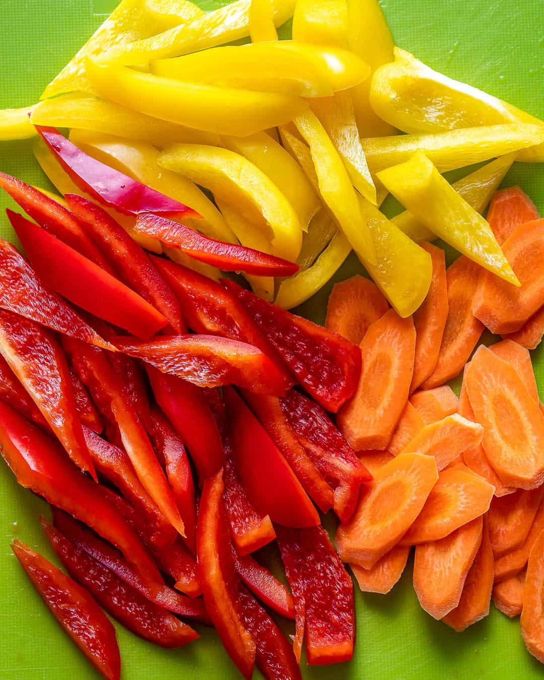 Bell peppers and carrots sliced for stir fry.