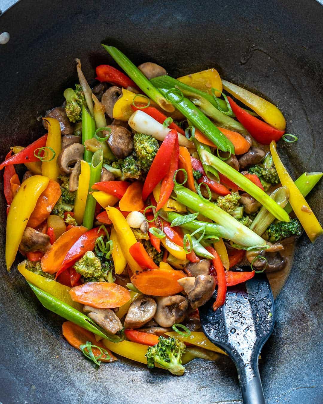Vegetables stir frying in wok.
