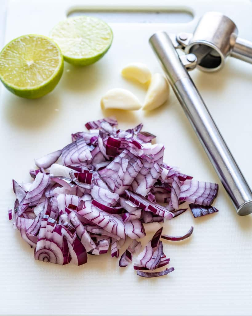 chopped onions om a white board