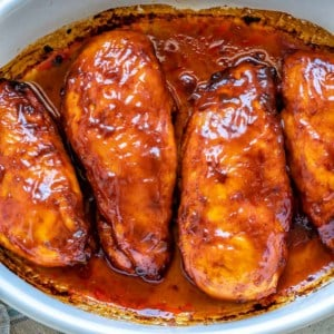 top view bbq chicken breast in white dish