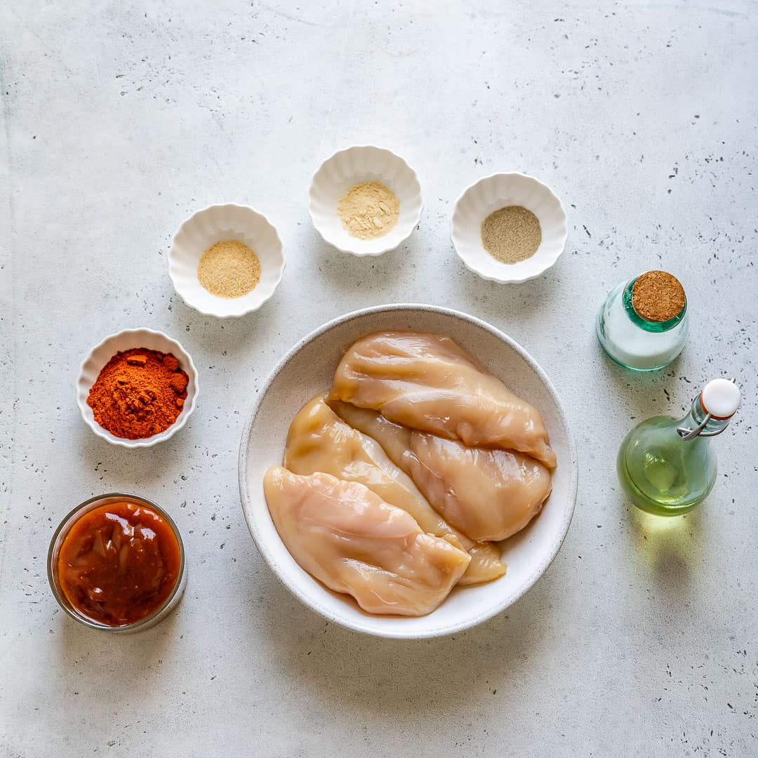 Ingredients for baked BBQ chicken breast on counter