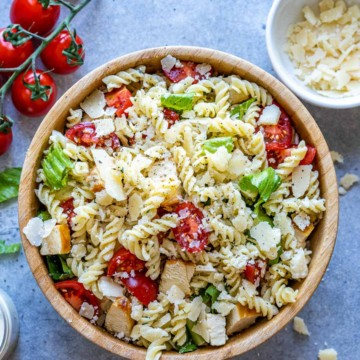 top view of chicken pasta salad in brown bowl