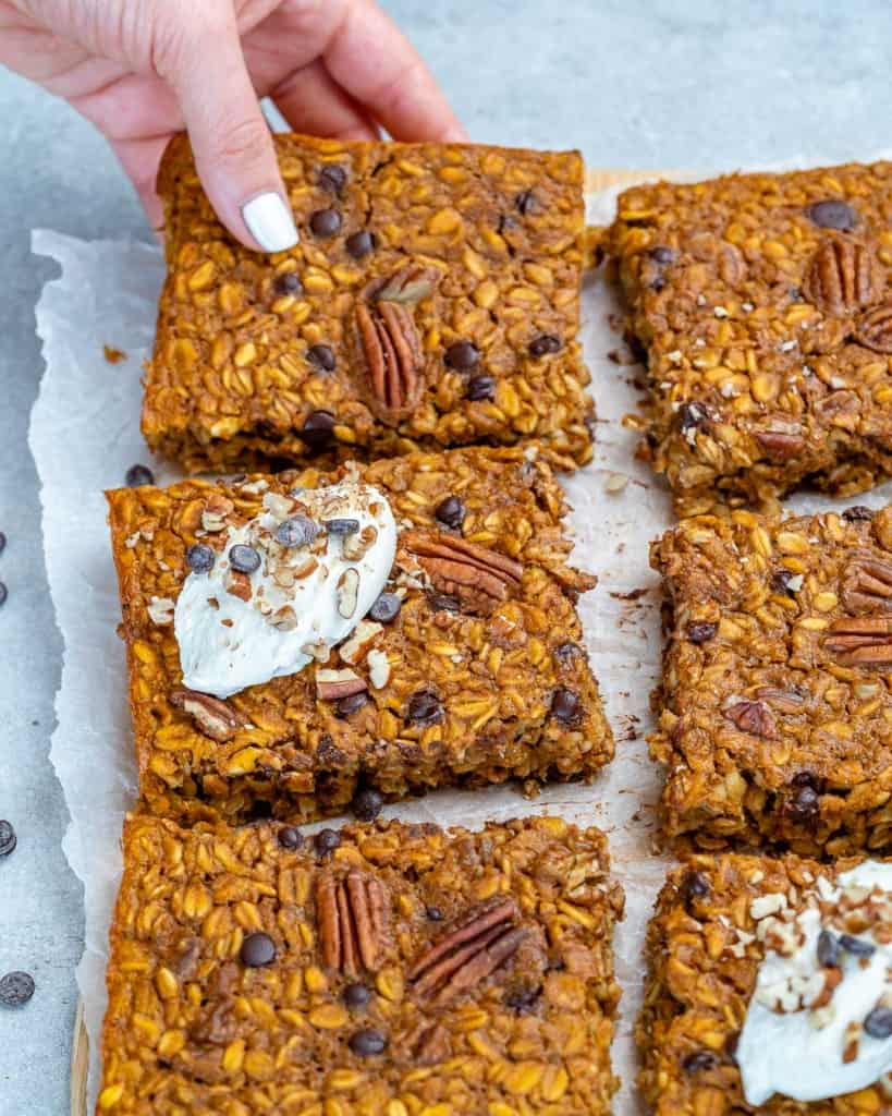 hand reaching for one oatmeal bake square