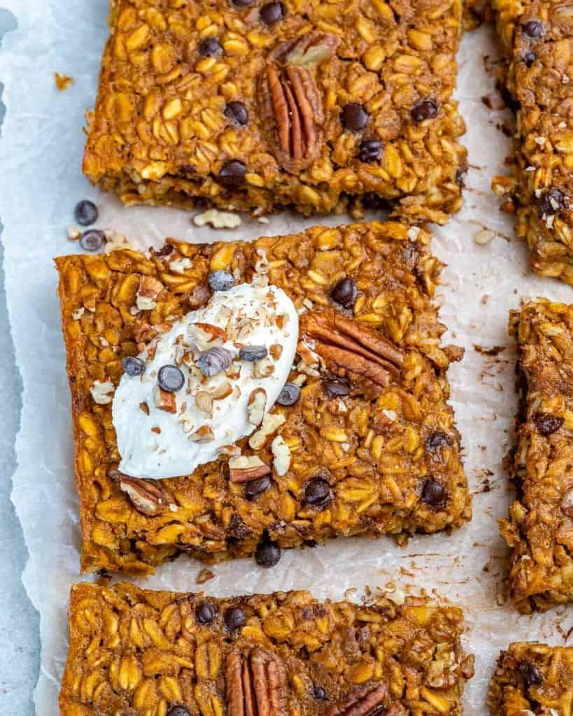 pumpkin baked oatmeal squares on a parchment paper