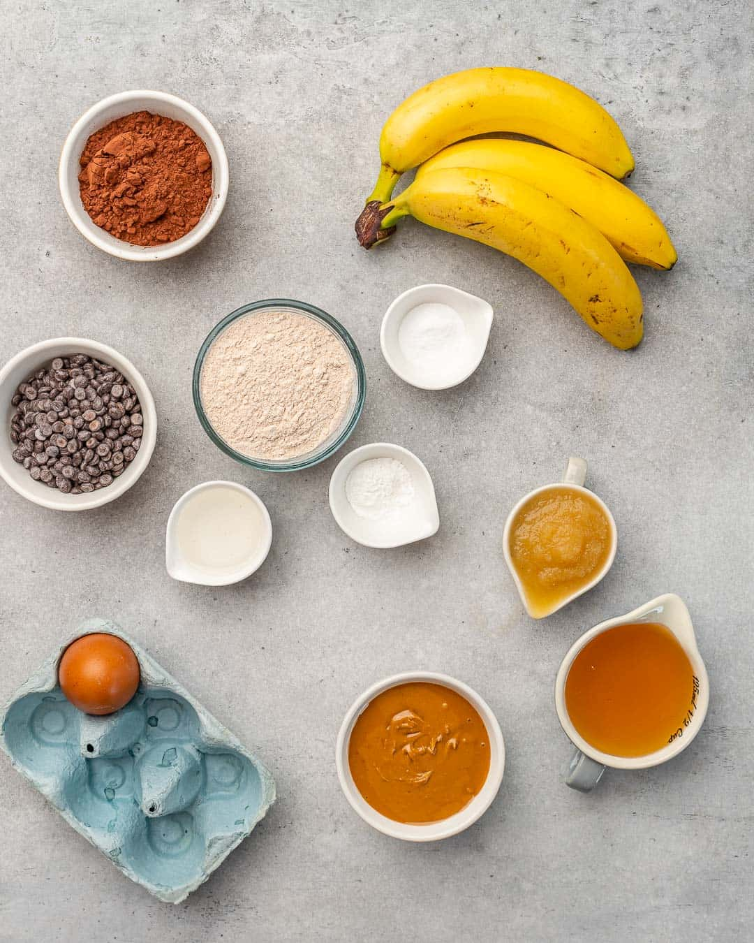 Ingredients for chocolate peanut butter banana muffins on counter