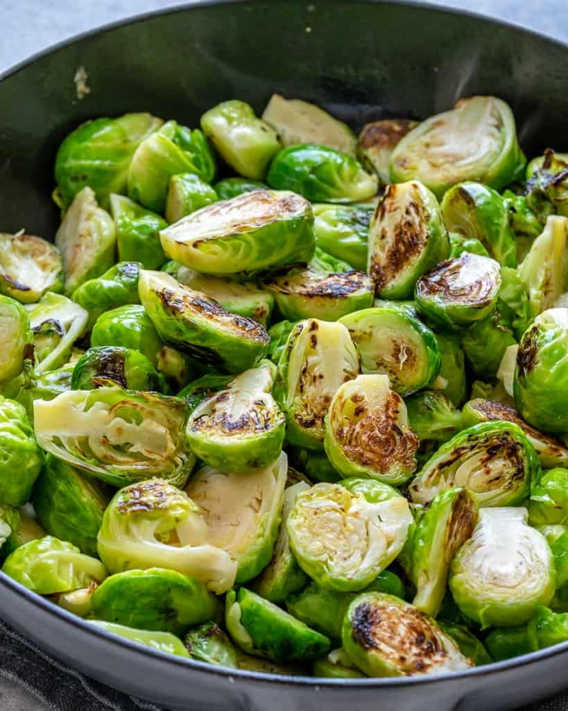 sautee brussel sprouts in black skillet