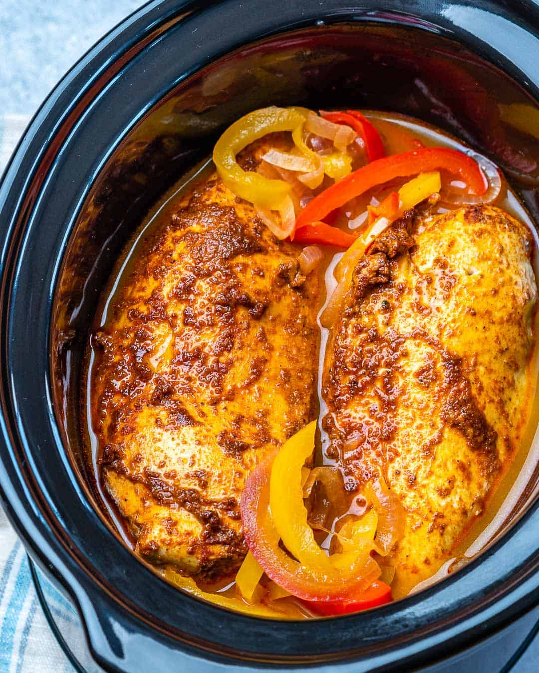 Whole chicken breasts and sliced bell peppers cooked in slow cooker.
