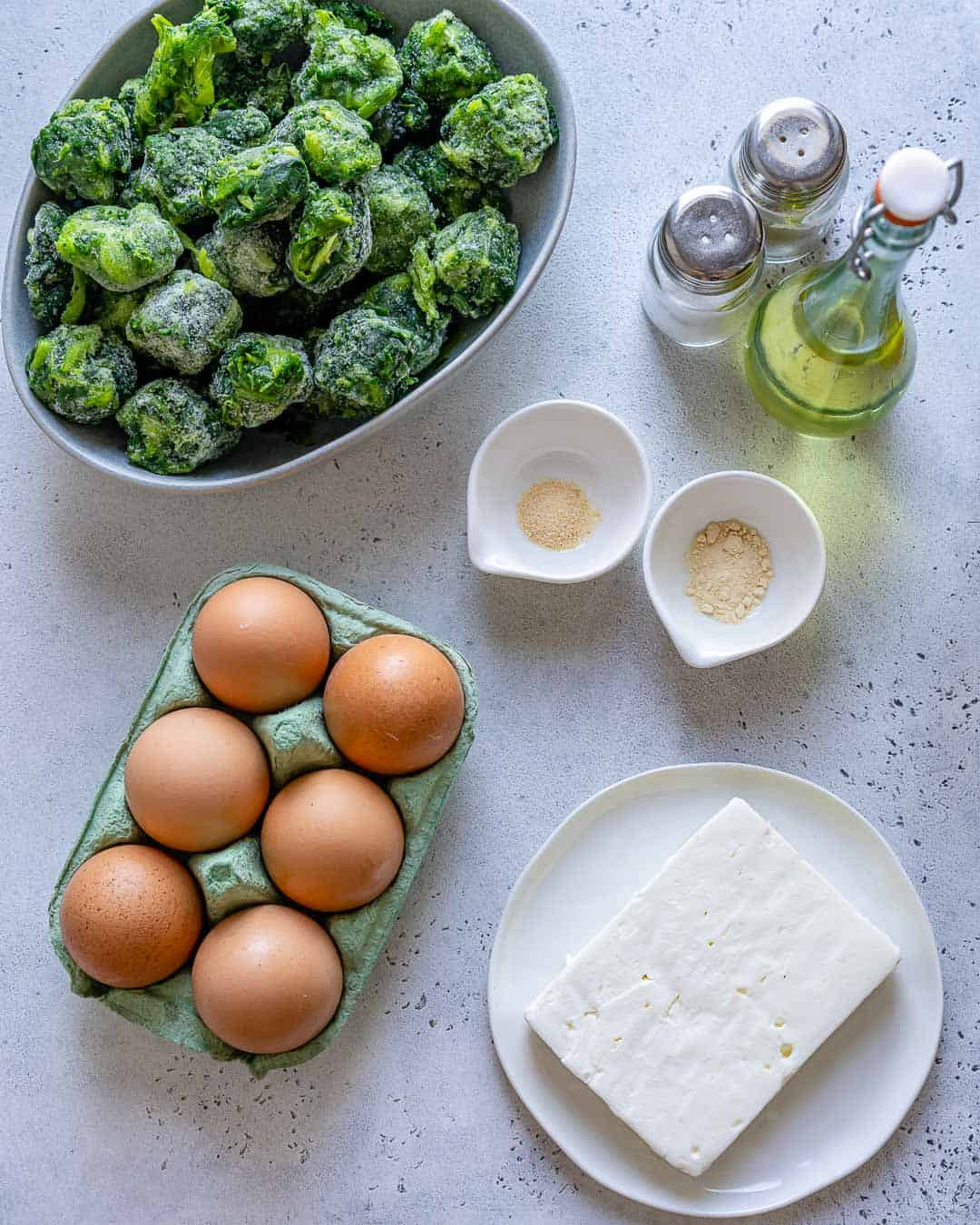 Ingredients for spinach feta baked egg cups on counter