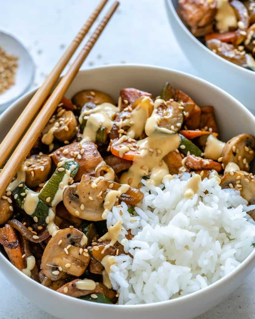 side shot of hibachi chicken bowl with rice