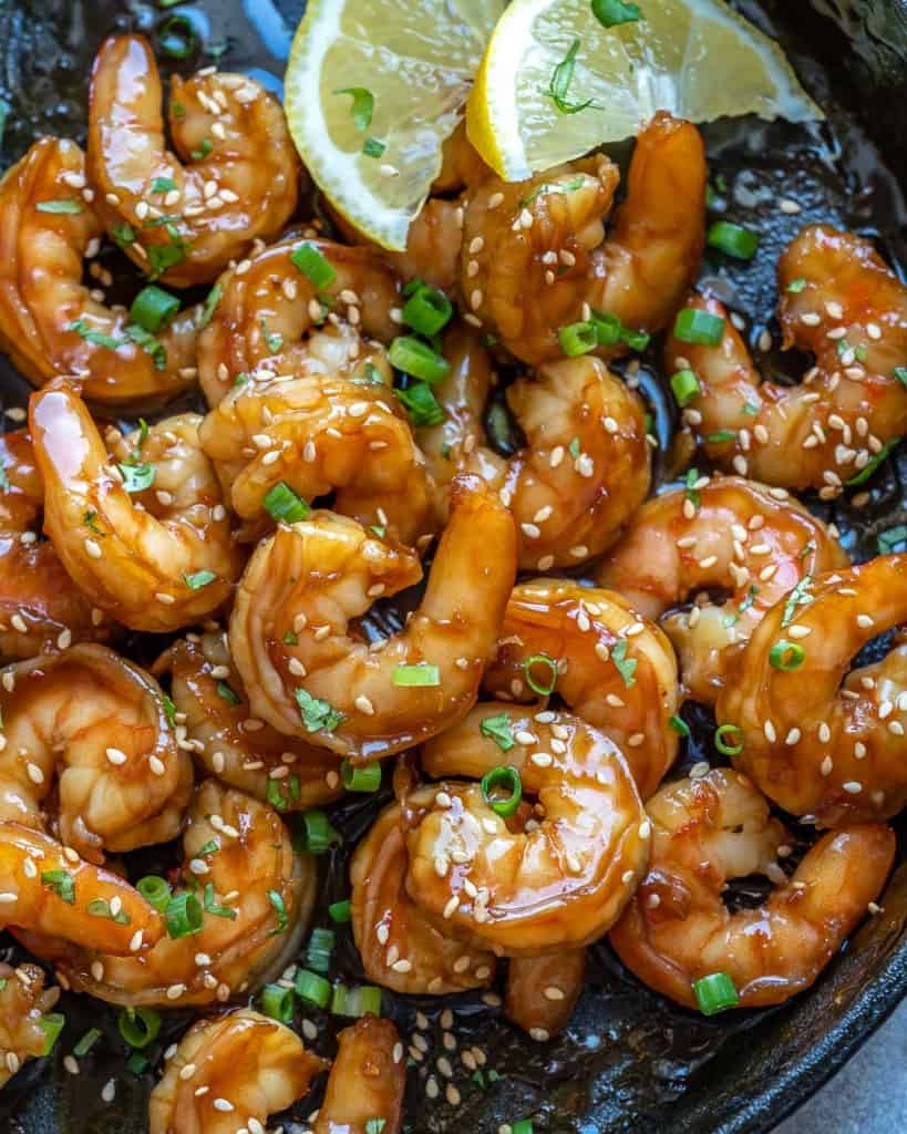 close up honey shrimp in a black skillet