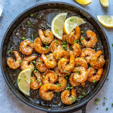 top view honey shrimp in black skillet