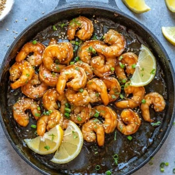 top view honey shrimp in a black skillet