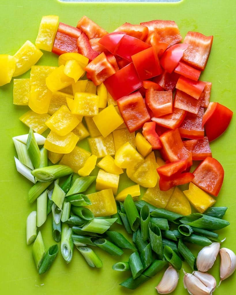 Green onions, garlic, red and yellow bell peppers