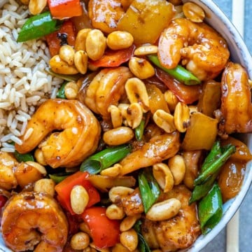 Top view of kung pao shrimp in white bowl
