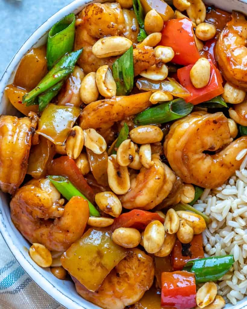Close view of kung pao shrimp in white bowl