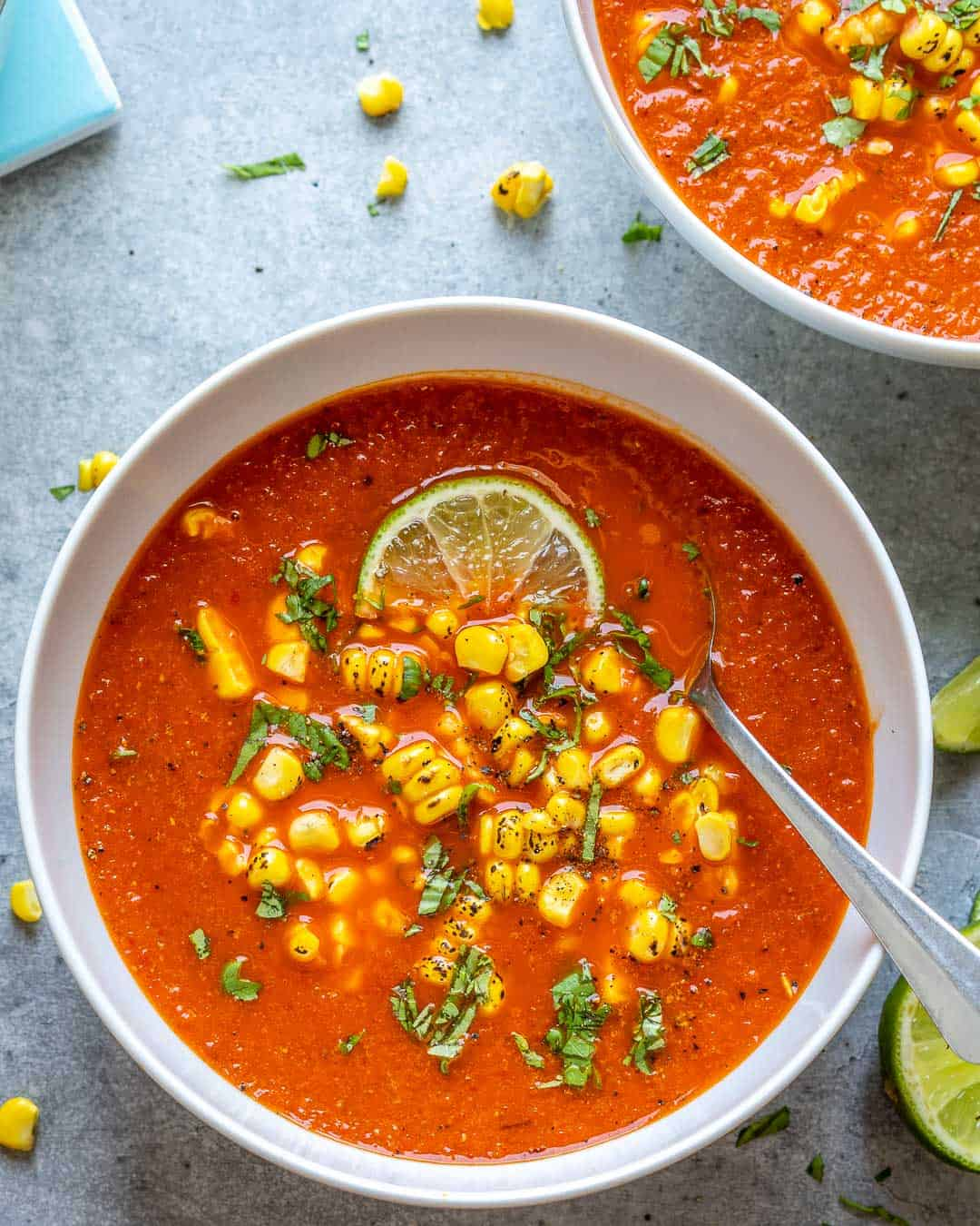 one bowl of Mexican sweet corn soup with lime and cilantro with spoon