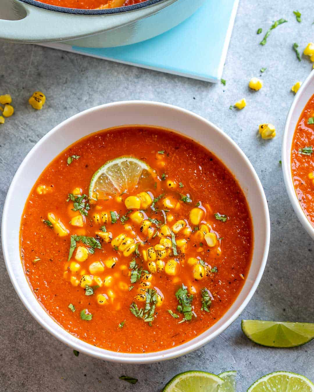 one white bowl of sweet corn soup with lime