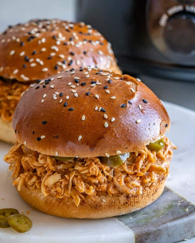 side view of chicken burger on a plate
