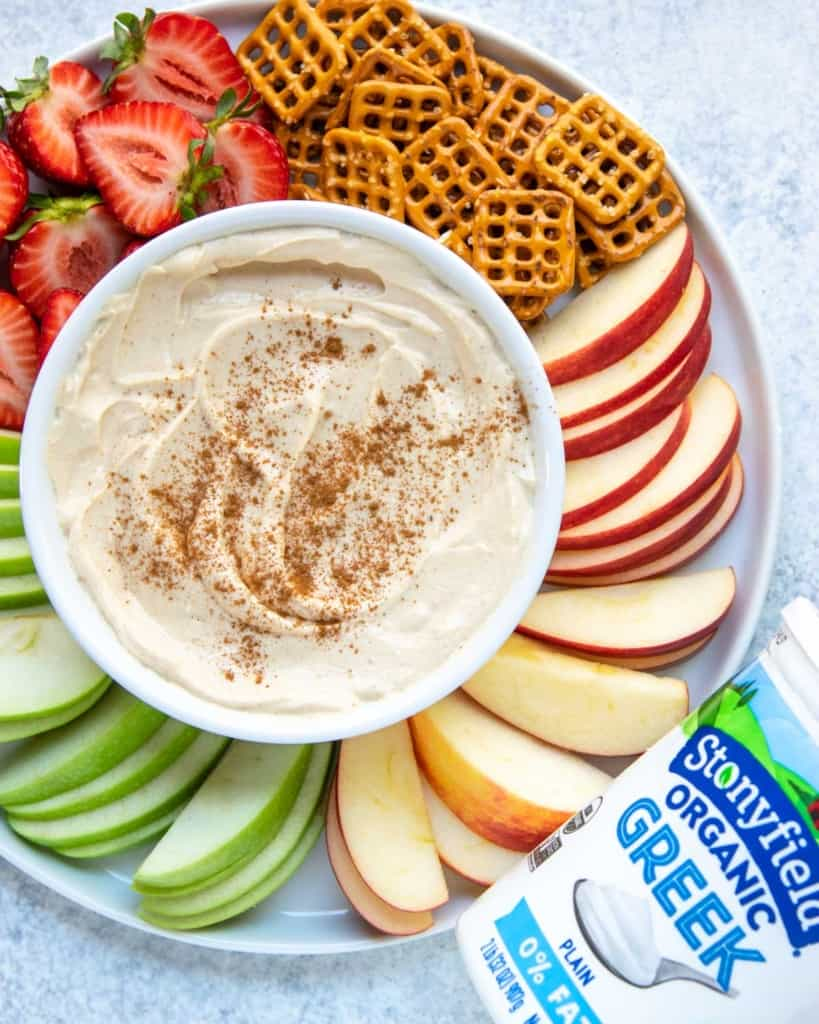 top view yogurt fruit dip bow with fruits around it
