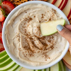 close up peanut butter fruit dip in a white bowl