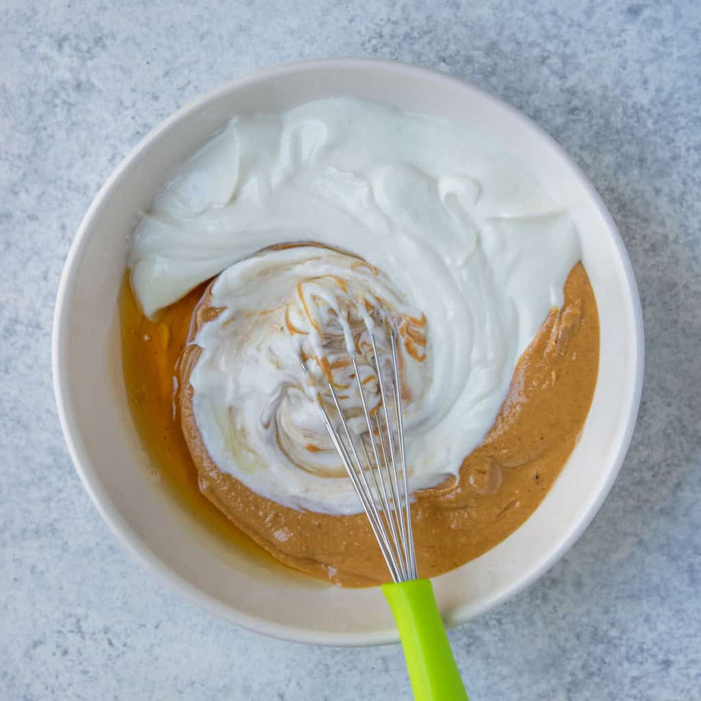 3 ingredients, yogurt, honey, and peanut butter in white bowl