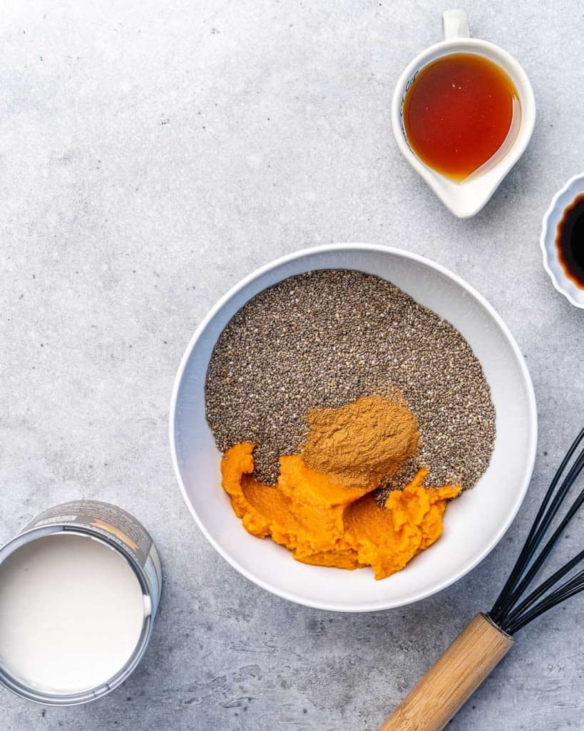chia and pumpkin puree in a white bowl