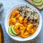 top view of shrimp curry with wild rice in a white bowl