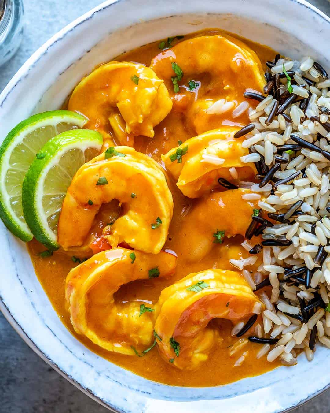 Bowl of shrimp curry with cooked rice