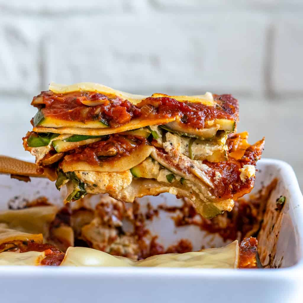 Spatula lifting slice of vegan lasagna out of pan