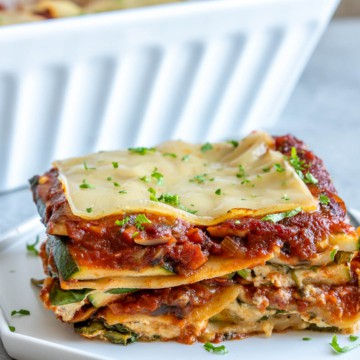 side view of lasagna piece on a plate