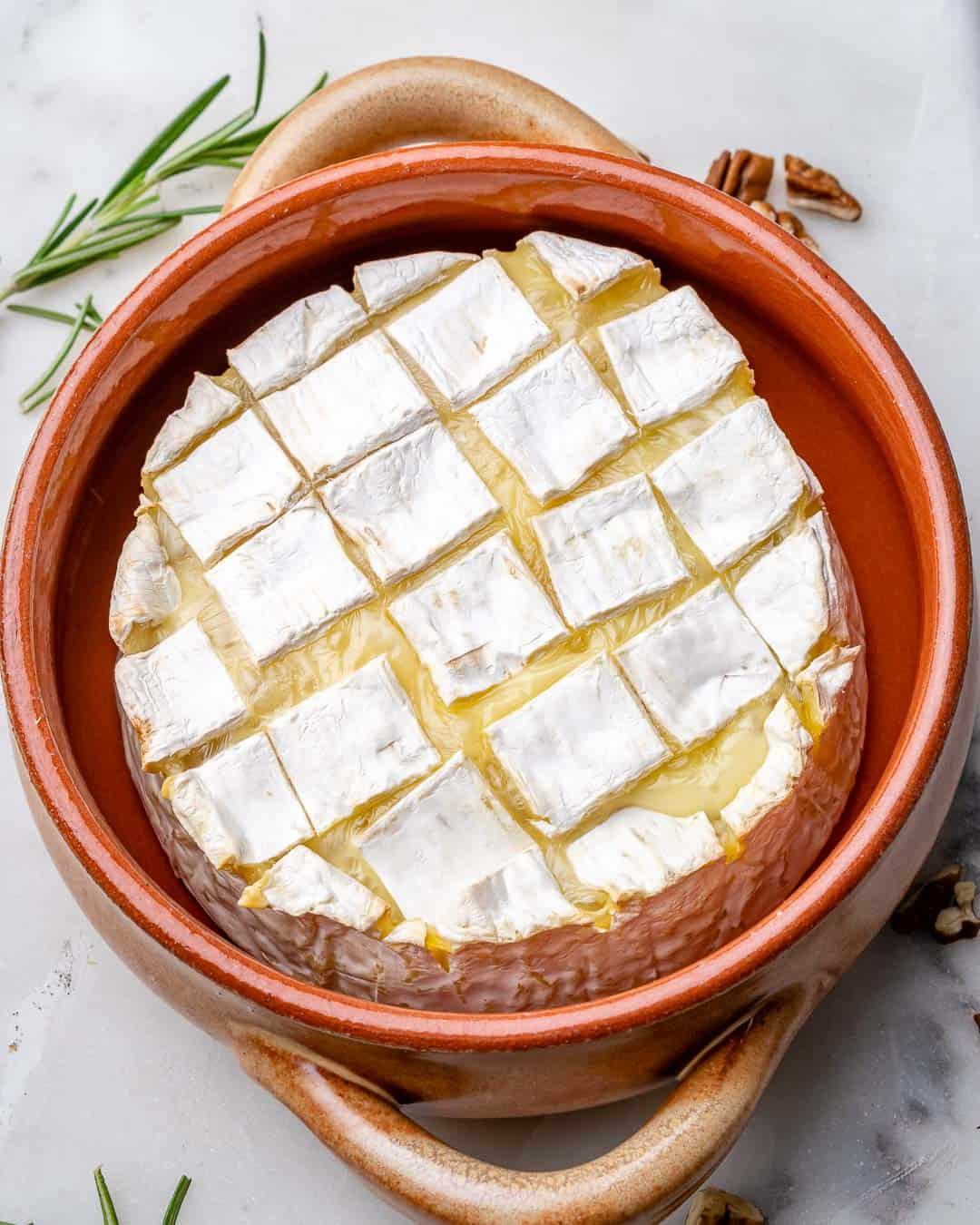 Brie cheese in baking dish after baking