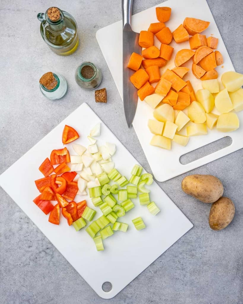 chopped veggies for chicken stew on a cutting board