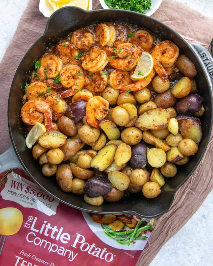 top view shrimp and potatoes in skillet