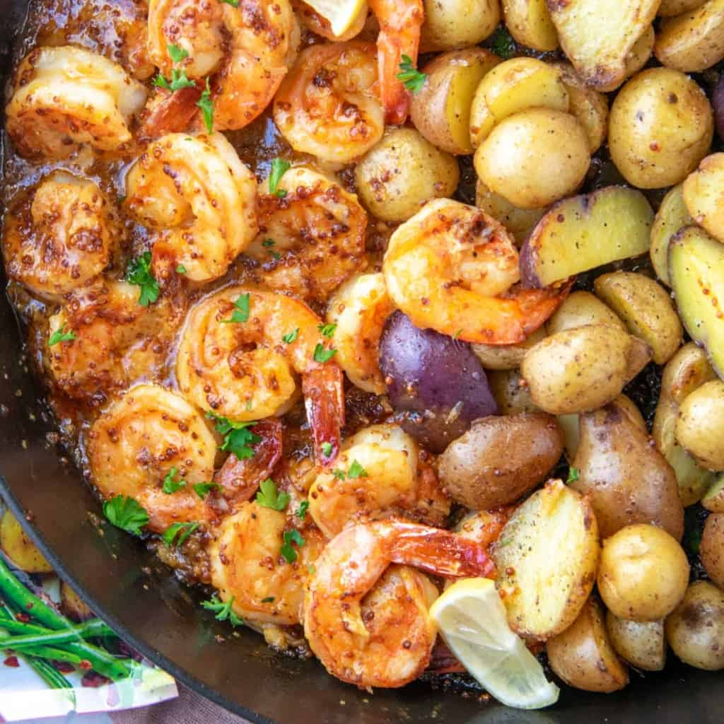 close up honey shrimps and roasted potatoes