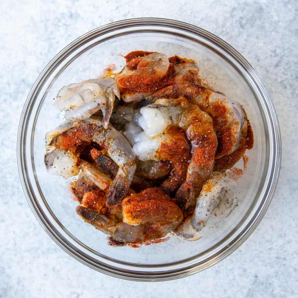 raw shrimp in bowl with spices on it