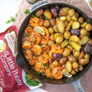 top view shrimp and potatoes in black skillet