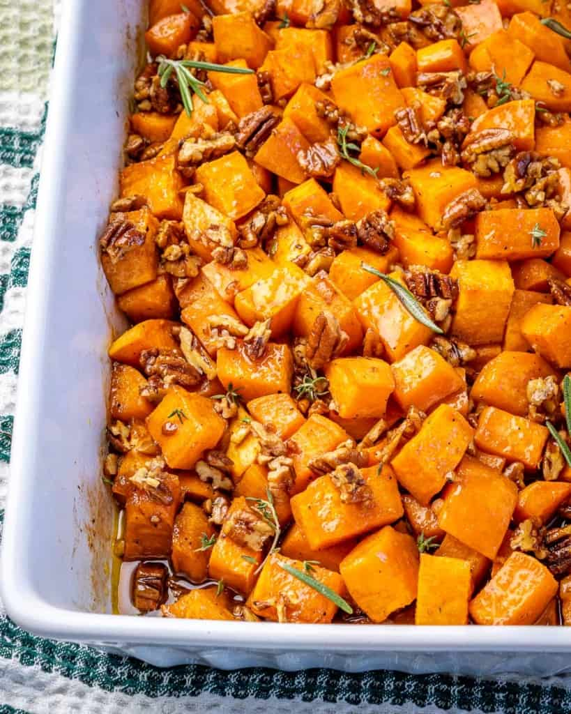 A baking dish with maple pecan roasted sweet potatoes.
